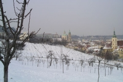 Snow covers the ground in front of Prague Castle