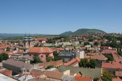 Blue sky overt the vibrant Eger roofscape