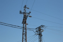 Power of Hungary: pylons against a rich blue sky