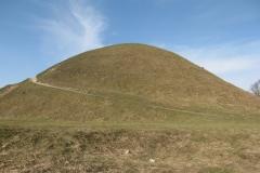 Krakus mound against a blue sky