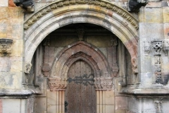 The carvings around the south door of the chapel