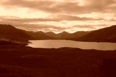 The sparkling waters of Loch Arklet in the evening sun
