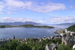 White clouds hang in the sky over Oban Bay