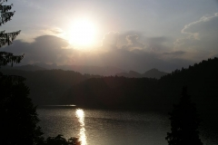 The sun setting over Lake Bled