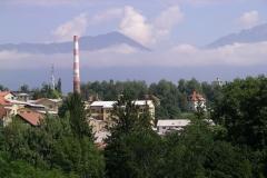 Mist hangs in the mountains over Kranj