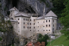 Predjama castle nestles in the cliff-face