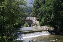 Water flows over the wear at Škofja Loka